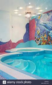 luxury swimming pool design with mosaic tile stock photo royalty
