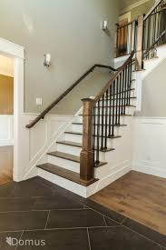 metal landing banister and railing staircase with white accents and black metal spindles new house