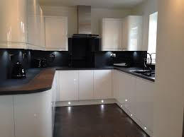 our new kitchen handless white gloss grey slate bench and flooring