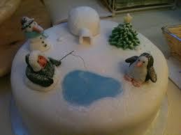 christmas cake winter scene with penguin igloo snowman