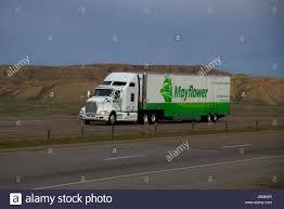 kenworth semi a white kenworth semi truck pulls a white and green