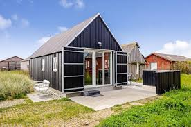 small house bliss small house designs with big impact this danish summerhouse was inspired by the neighboring fishermen s sheds it has one bedroom on