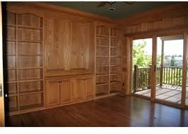 stained wood panels staining wood floors but now wood paneling and bookshelves