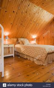 bedroom with furnishings and knotty pinewood floor walls and