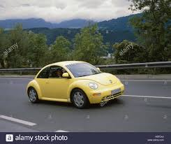 volkswagen beetle yellow vw beetle yellow country road marks unrecognizable make stock