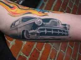 beautiful grey car tattoo on arm