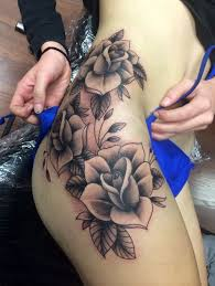 amazing black and white flowers on thigh tattoos