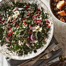 kale salad with quinoa pistachios and pomegranate seeds