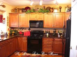 ideas for tops of kitchen cabinets decorating above kitchen cabinets tuscany here s a closer look