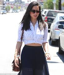 blouse pops open munn looks stop traffic gorgeous as she bares midriff and