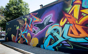 take a look at 15 new murals splashed on downtown lynn s brick lynn artists temp and relm s mural on oxford street