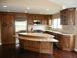 hickory cabinets with granite countertops dark hardwood floors with hickory stained cabinets and a light