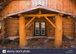 cabin style cottage style residential log home facade in autumn quebec