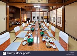 traditional japanese style dining room for guests staying at stock