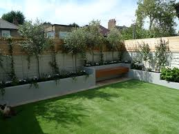 i like the combination of concrete planters up against the fence