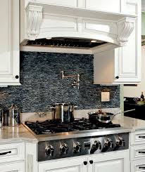 black pebble backsplash in classic french kitchen michael nash