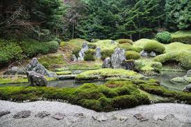 peaceful japanese zen garden with pond rocks gravel and moss