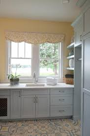 gray kitchen cabinets yellow walls yellow and blue laundry room colors transitional laundry