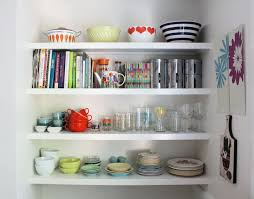 cabinets drawer white hanging open shelves and spice jars also full size of colorful bowls cookbooks stainless steel canister and glasses also dinner wares inspiring eclectic