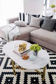 white living room table living room black and white rug aztec mayan kilim cococozy