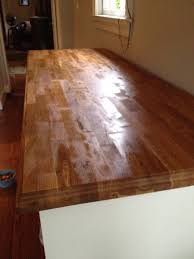 walnut butcher block elegant kitchen photo in new york with wood