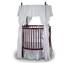 beautiful oval  round baby cribs for unique nursery decor with this round crib is crafted in cherry wood with fixed sides for enhanced  stability from homestratospherecom