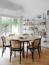 love the unexpected cane back chairs in this dining room they