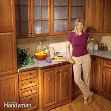 How To Fix Cabinet Drawer Slides How To Refinish Kitchen Cabinets Family Handyman