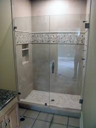 bathroom frameless shower doors matched with tan wall for