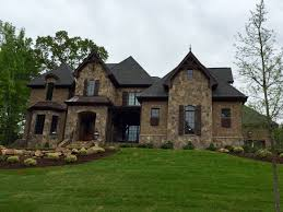 exterior mansard roof extension with stone wall for impressive