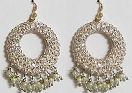 ear ring photo white studded earring kerala news kerala breaking