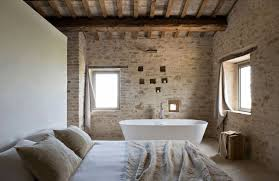 rustic bedroom and bathroom in style minimal stone wall
