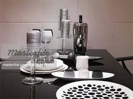 black white and silver decorations on dining table stock photo