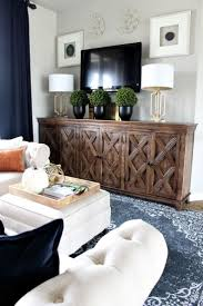 best 25 modern family rooms ideas only on pinterest green a modern family room loft featuring beautiful burnt orange pillows blue wool rug brass