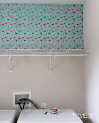 how to hang wrapping paper as wallpaper the homes i made
