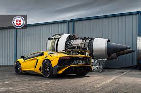 lamborghini jet lamborghini aventador sv poses next to jet engines