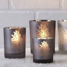 frosted glass tree silhouette candle holder by ella