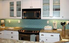 white kitchen cabinets with aqua backsplash this aqua backsplash with the brown granite i may use