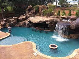 free form pool natural accents boulders grotto jewelscapes
