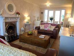 how to decorate a long living room with fireplace in the middle