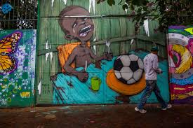 brazil s world cup stadium in manaus highlights out of control graffiti on a wall of a public school criticizes the hosting of the world cup on