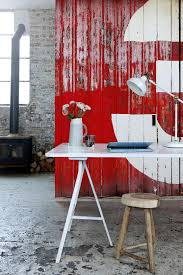 industrial revolution factory inspired interiors for your family this trompe l oeil mural from textures collection is so convincing it s tempting to see if the door handles work the print called rusty corrugate