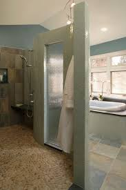 pebble rock floor bathroom style with shower enclosure
