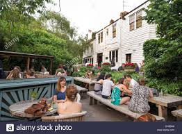 Backyard Beer Garden - people in the beer garden of the spaniards inn london england