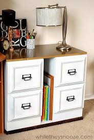 metal filing cabinet makeover glue picture frames to file cabinet drawer fronts for an updated