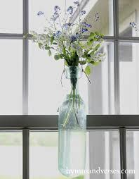 repurposed vintage bottles hanging vases hymns and verses
