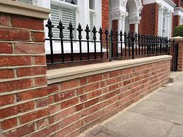 garden brick wall design ideas red brick london wall with stone effect caps and solid metal rail