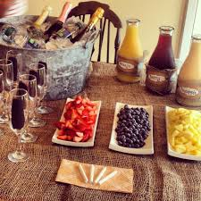 mimosa bar for a rustic themed bridal shower champagne glasses