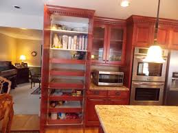 dark brown cherry wood pantry cabinet combined white kitchen two