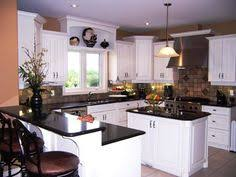 Kitchens With White Cabinets And Black Countertops thompson kitchen white cabinets with absolute black leather